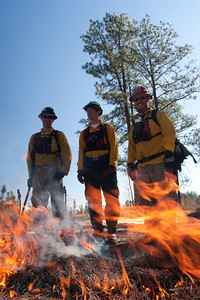 Prescribed fire personnel in PPE during burn.