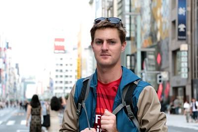 "I met Martin from Australia at the Ginza pedestrian promenade. I asked him: ""What makes you sad?"" ""Not traveling.""  オーストラリア出身のマーティン。 彼に尋ねてみた。 「何がマーティンを悲しくさせる?」 「旅行できないこと。」"
