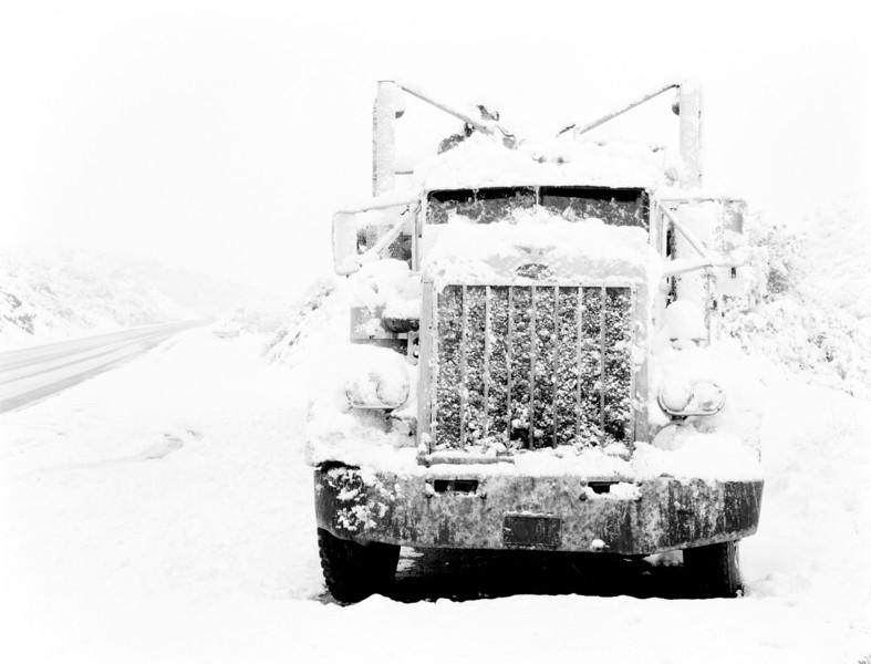 broken Pete tractor in Snow Storrm Near Globe AZ