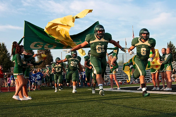 81 Jordan VanDort and 6 Zach Poppema lead the Dux onto the field for the start of the game.