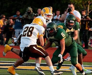 ZW Zach Poppema lines up for a tackle on ZE ball carrier 28 Corey Westra