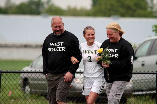 Zeeland West Soccer Senior #3 Breanna McKellar and her parents