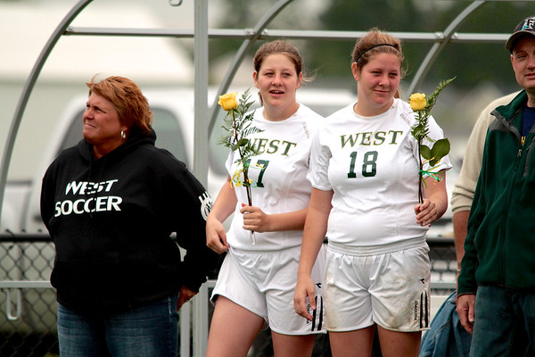 Zeeland West Soccer Seniors #17 Alisha Nemec, #18 Asha Nemac and their parents.
