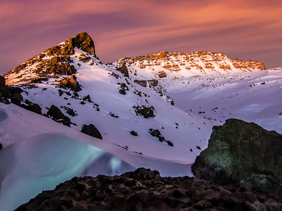 Another shot of sunrise along the crater rim. Uhuru Peak, the highest point is the furthest high point visible in this shot.