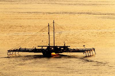 Fishing boat at sunset, Larantuka, Indonesia 27 November 2011