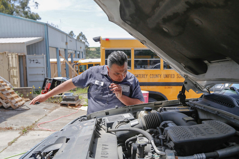 Vehicle maintenance technician, Andrei Rayas, named 2017 Classified School Employee of the Year in the Transportation category, sniffs a dipstick on a maintenance vehicle at North Monterey County Unified School District's maintenance and transportation yard on Tuesday, April 25, 2017 in , Calif. (Vernon McKnight/Herald Correspondent)