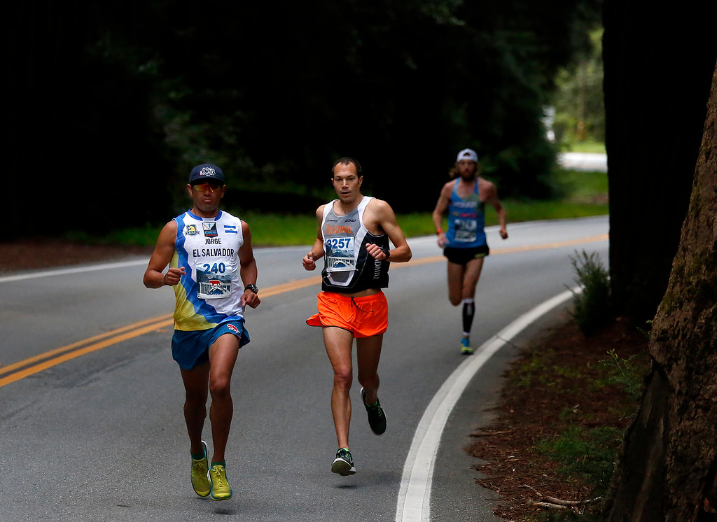 . Jorge Maravilla, right, leads Adam Roach and Michael Wardian through Big Sur Village during the Big Sur Marathon on Sunday April 29, 2018. Roach won the race, Maravilla took second and Wardian placed third. (David Royal/ Herald Correspondent)