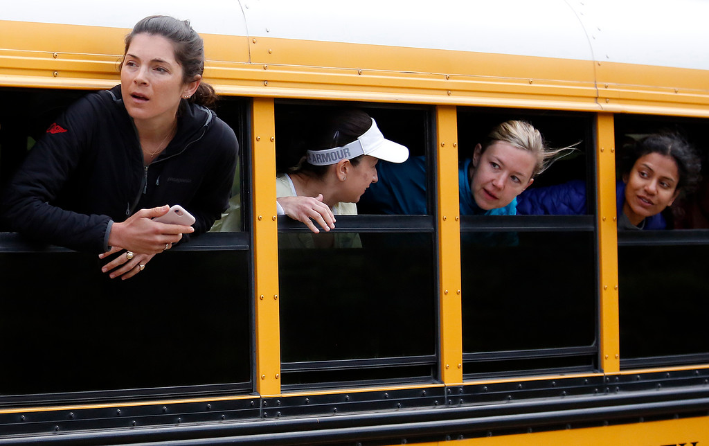 . Relay runners watch from bus windows as the lead male runners pass by during the Big Sur Marathon in Big Sur, Calif. on Sunday April 29, 2018. (David Royal/ Herald Correspondent)