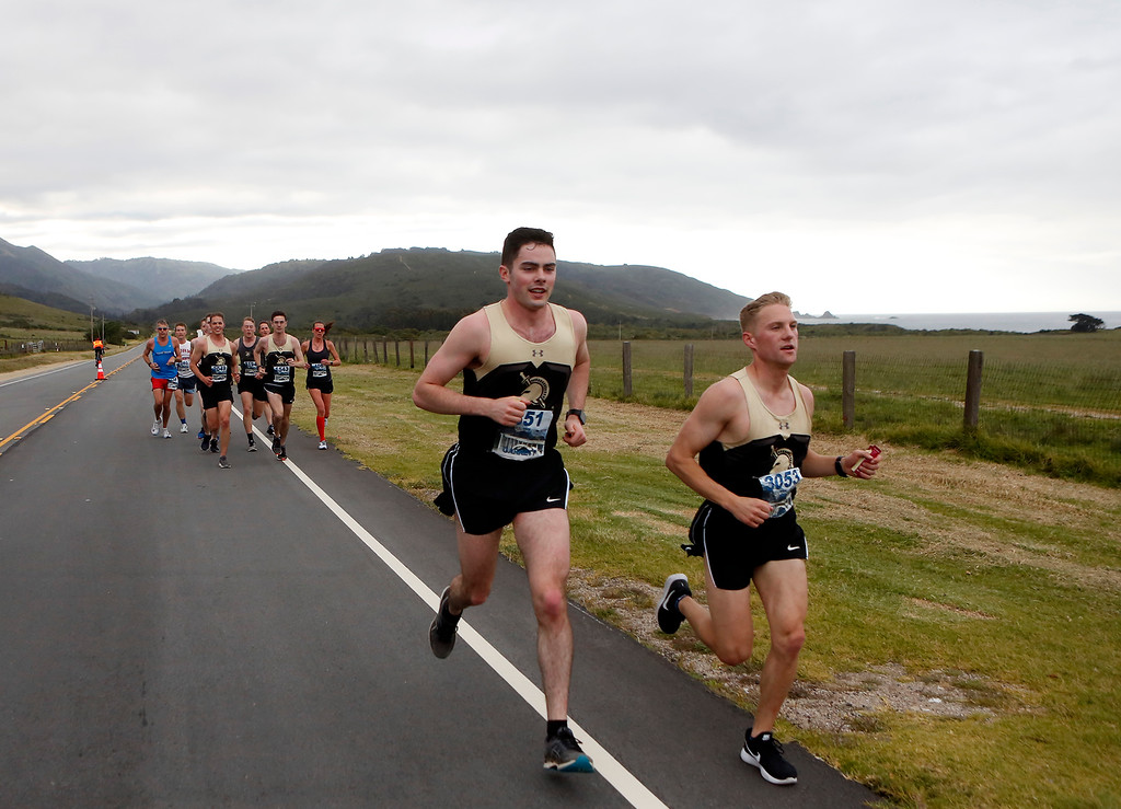 . A group of runners from West Point pass Andrew Molera State Park during the Big Sur Marathon in Big Sur, Calif. on Sunday April 29, 2018. (David Royal/ Herald Correspondent)