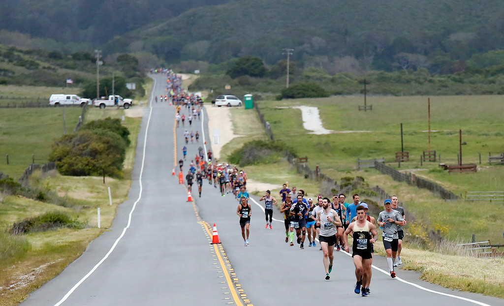 . Runners make their way past Andrew Molera State Park during the Big Sur Marathon in Big Sur, Calif. on Sunday April 29, 2018. (David Royal/ Herald Correspondent)