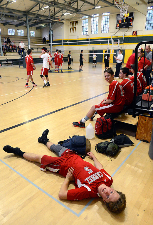 . Carmel\'s Ben Airola lays on the ground after hurting his back during boys volleyball against Monterey in Monterey on Tuesday April 11, 2017. (David Royal - Monterey Herald)