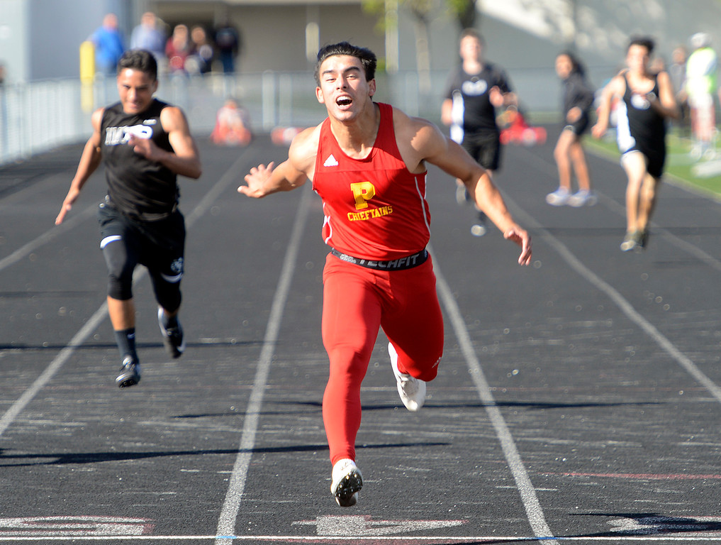 . Palma\'s Emilio Martinez stretches across the finish line to win the boys 100 meter dash during a track meet against North Monterey County at Palma High School in Salinas on Thursday April 13, 2017. Martinez finished at 11:41. (David Royal - Monterey Herald)