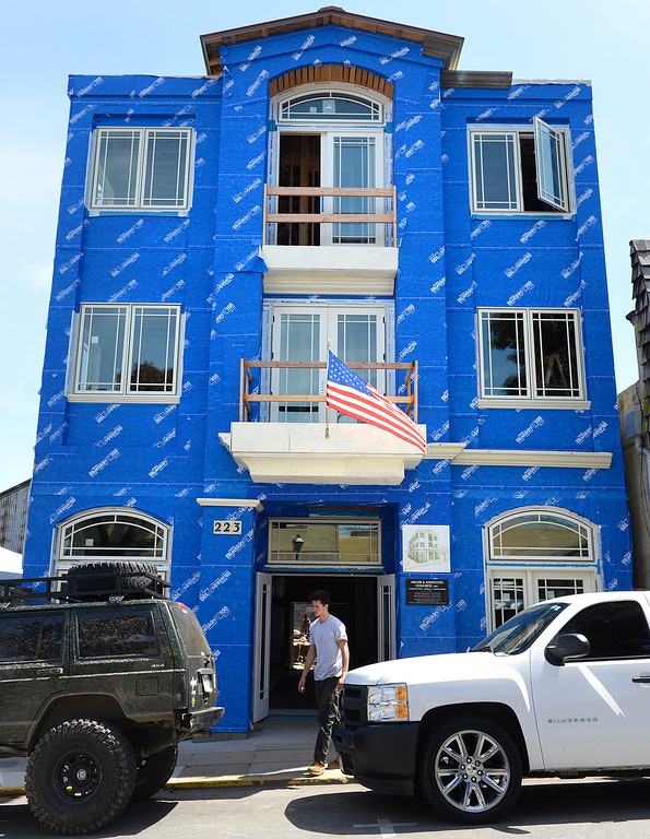 . Kane Miller walks in front of a new mixed use building his father\'s company is developing on Grand Avenue in downtown Pacific Grove on Monday April 10, 2017. The building will have apartments on the top two floors and a commercial space downstairs. (David Royal - Monterey Herald)