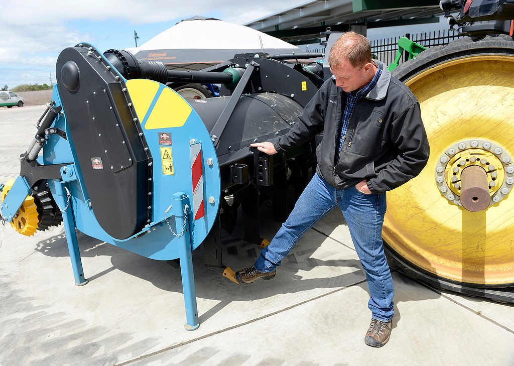 . Erik Van Der Vis uses his foot to point out subsoilers under the Dutch-built Imants Spader during the Ag Tech Summit at Hartnell College Agriculture Business & Technology Institute in Salinas on Wednesday April 12, 2017. The farming implement is billed as a one pass solution instead of the multiple passes that disking a field takes. (David Royal - Monterey Herald)