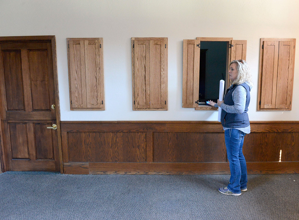 . Monterey County Fair and Events Center CEO Kelly Violini stands at one of the wager windows inside Monterey Bay Race Place off-track betting venue at the Monterey County Fair and Events Center in Monterey on Monday April 10, 2017. The facility is housed in the former Turf Club. (David Royal - Monterey Herald)