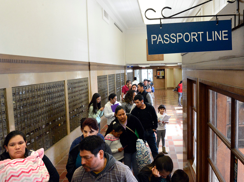 . People wait in a long passport line at the Stenbeck Post Office on West Alisal in Salinas on Thursday April 13, 2017. (David Royal - Monterey Herald)