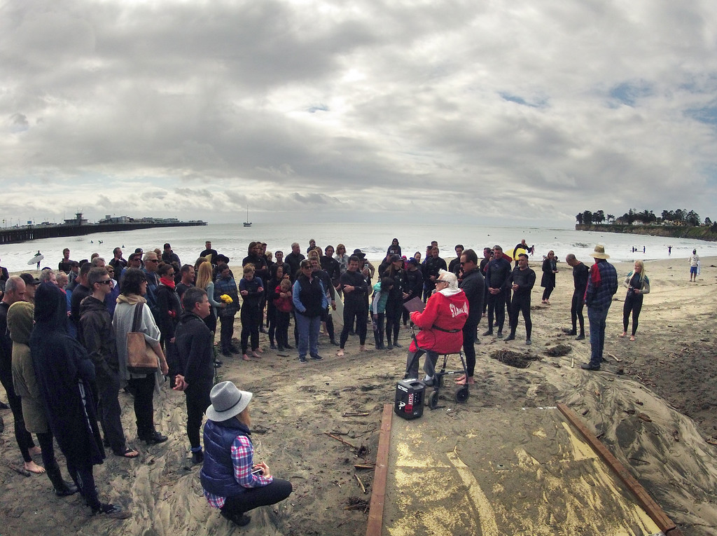 . Rev. Herb Schmidt says a prayer the paddle out memorial for surfer Matt Hamil at Cowell\'s Beach in Santa Cruz on Saturday April 8, 2017. (David Royal - Monterey Herald)