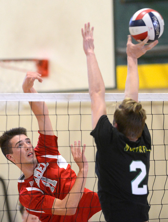 . Carmel\'s Jared McNally, left, hits the ball across against Monterey\'s Boaz Van Heukelem during boys volleyball in Monterey on Tuesday April 11, 2017. (David Royal - Monterey Herald)