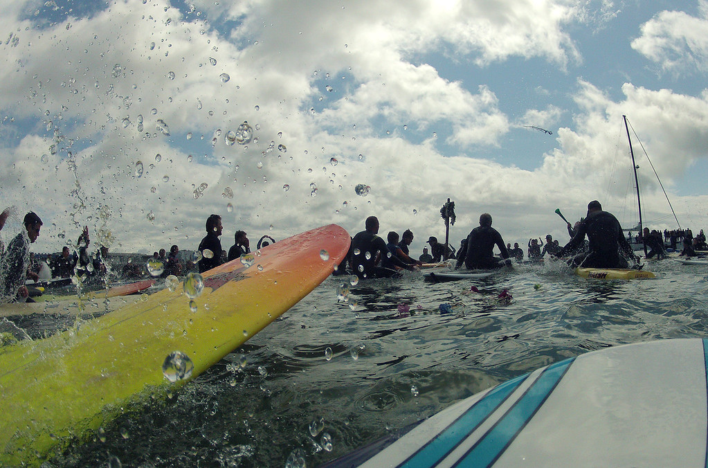. Paddlers splash water during a paddle out memorial for surfer Matt Hamil at Cowell\'s Beach in Santa Cruz on Saturday April 8, 2017. (David Royal - Monterey Herald)