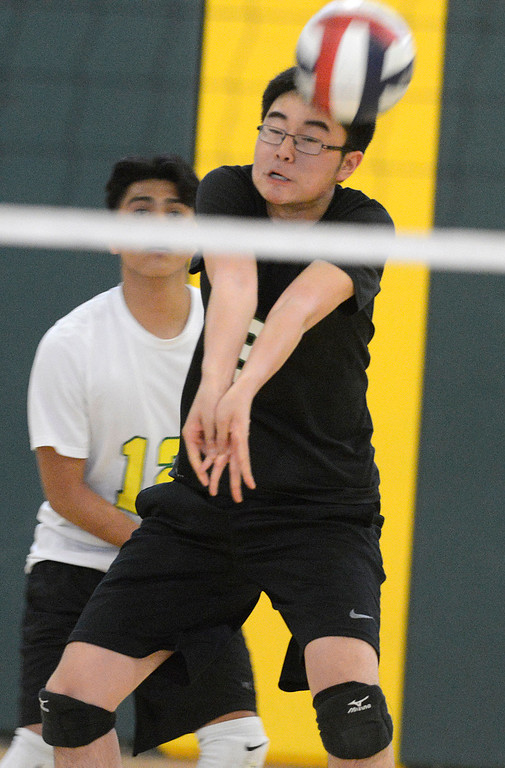 . Monterey\'s Chris Han digs the ball across during boys volleyball against Carmel in Monterey on Tuesday April 11, 2017. (David Royal - Monterey Herald)