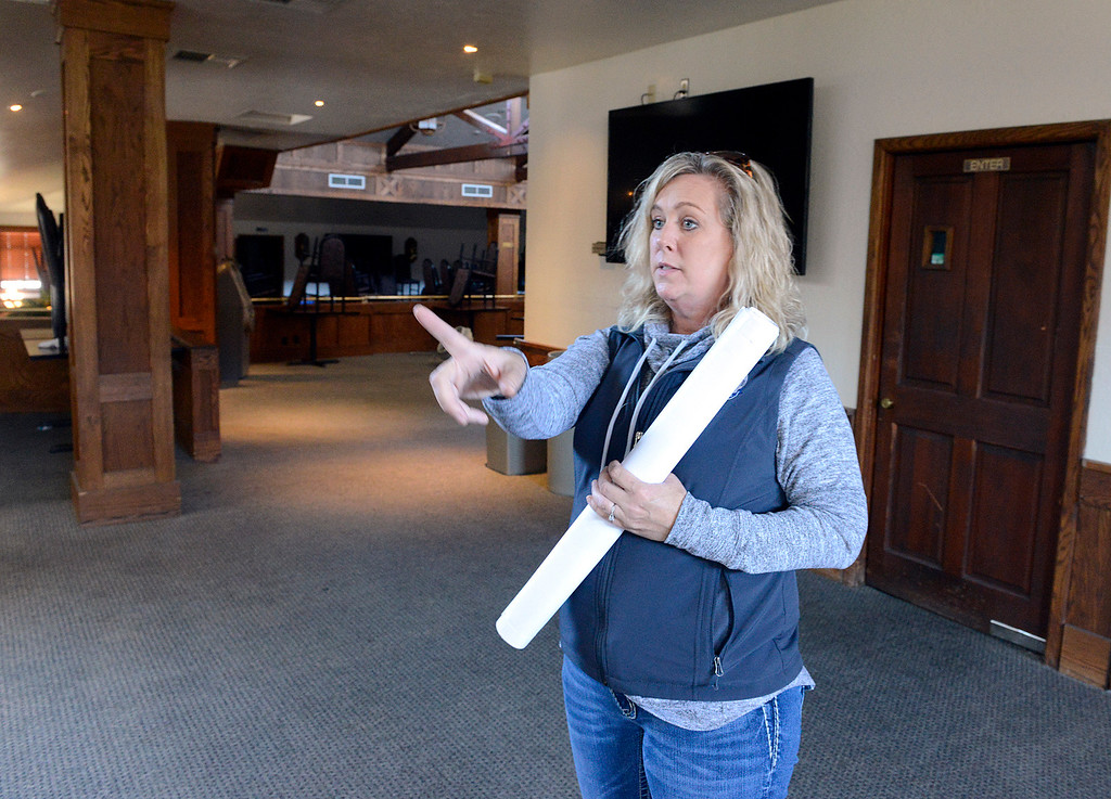 . Monterey County Fair and Events Center CEO Kelly Violini points to the bar area inside Monterey Bay Race Place off-track betting venue at the Monterey County Fair and Events Center in Monterey on Monday April 10, 2017. The facility is housed in the former Turf Club. (David Royal - Monterey Herald)