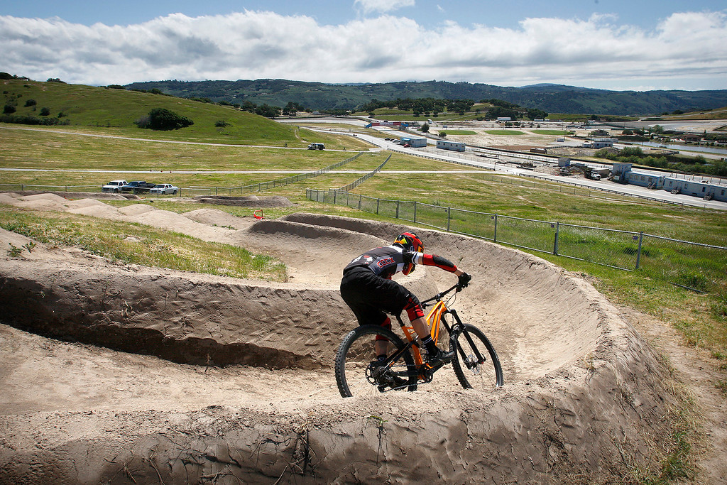 . Keith DeFiebre, dual slalom course designer bikes part of the course on April 12, 2017 at Laguna Seca for the upcoming Sea Otter Classic.  (Vern Fisher - Monterey Herald)