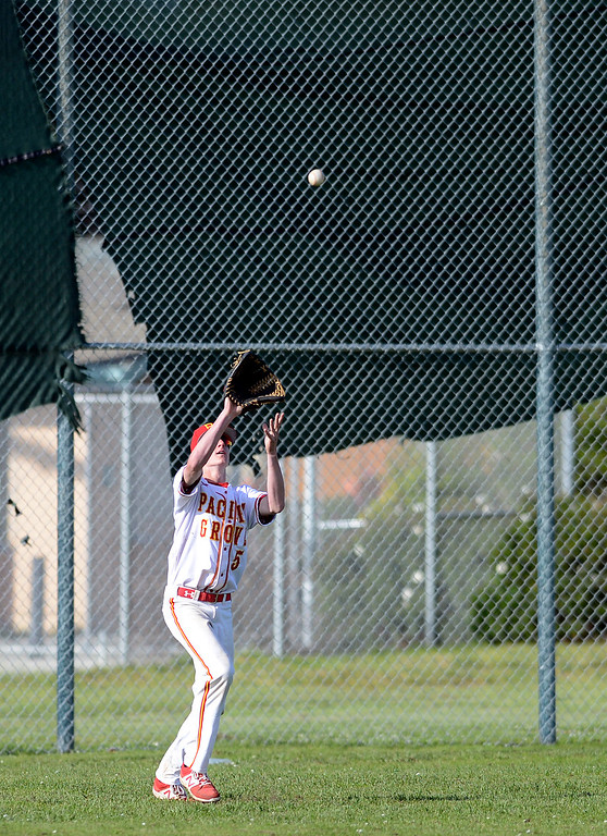 . Pacific Grove\'s Hunter Hanes reels in a fly ball at center field during baseball against Monte Vista Christian in Pacific Grove on Wednesday April 12, 2017. (David Royal - Monterey Herald)