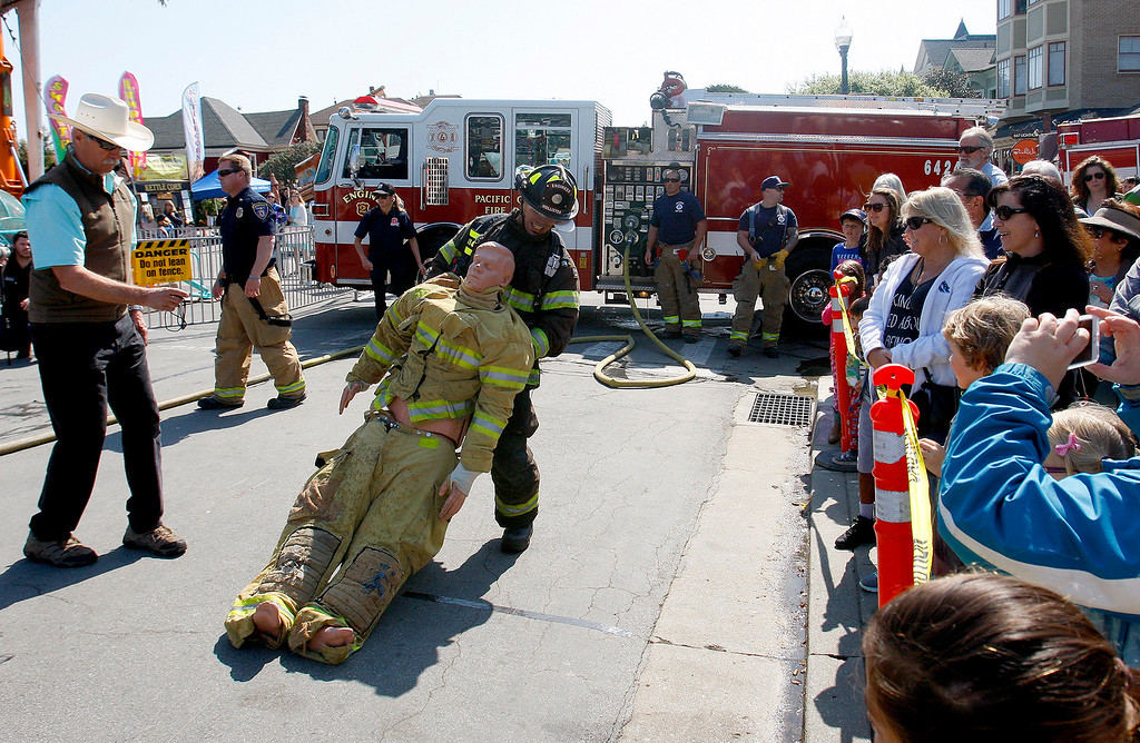. Participants in the Firefighter\'s Combat Challenge on Sunday, April 9, 2017 at the 60th Pacific Grove Good Old Days festival.  (Vern Fisher - Monterey Herald)