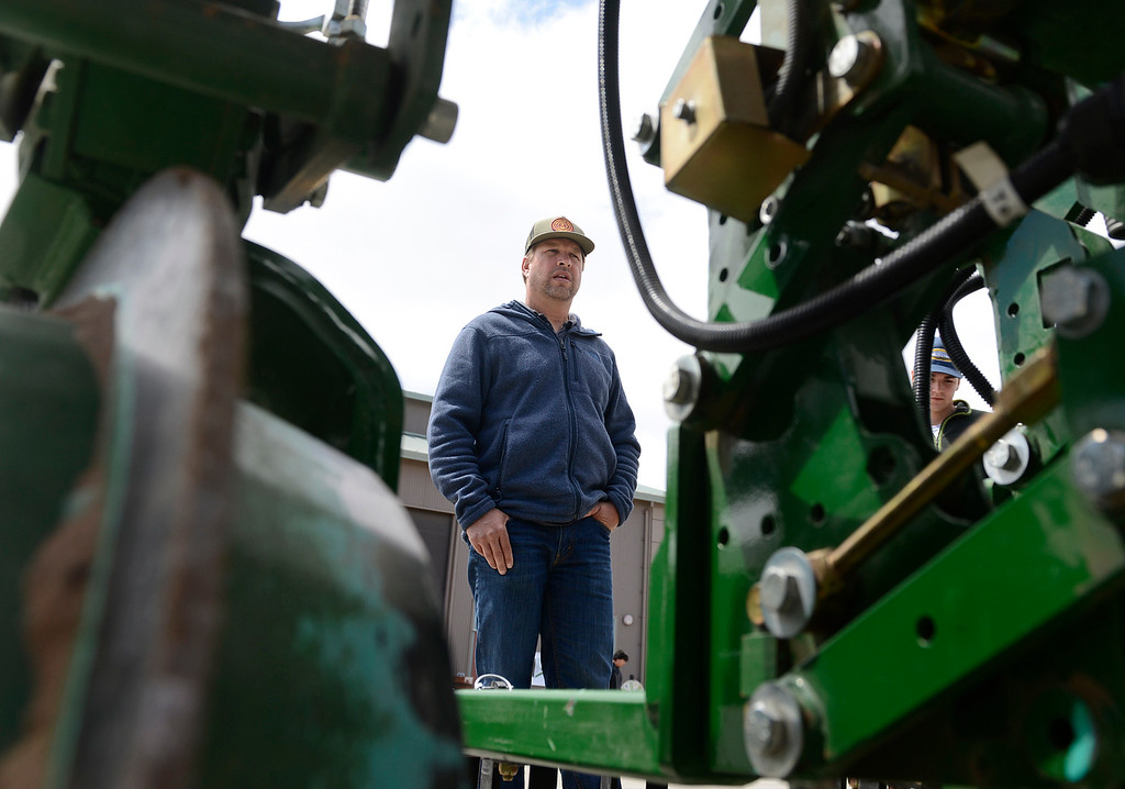 . Hibino Farms ranch manager Tim Keller, left, and his nephew Tyler Pattullo looks at the business end of a Garford Robocrop InRow Weeder implement during the Ag Tech Summit at Hartnell College Agriculture Business & Technology Institute in Salinas on Wednesday April 12, 2017. The tractor attachment is designed to weed around row crops imported from England. (David Royal - Monterey Herald)