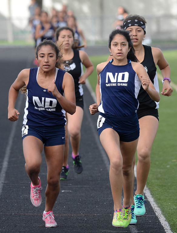. Notre Dame\'s Maria Aceves, second from right, leads on her way to a win in the girls 1600 meter race during their track meet against North Monterey County at Palma High School in Salinas on Thursday April 13, 2017. North Monterey County\'s Faith Mora, right, took second, and Notre Dame\'s Shantal Martinez, left, took third. (David Royal - Monterey Herald)
