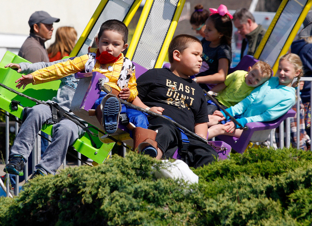 . Kids enjoying carnival rides on Sunday, April 9, 2017 at the 60th Pacific Grove Good Old Days festival.  (Vern Fisher - Monterey Herald)