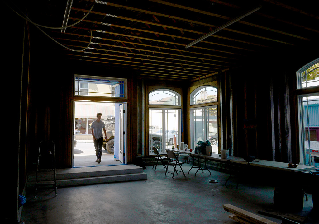 . Kane Miller walks through the front door of a new mixed use building his father\'s company is developing on Grand Avenue in downtown Pacific Grove on Monday April 10, 2017. The building will have apartments on the top two floors and a commercial space downstairs. (David Royal - Monterey Herald)