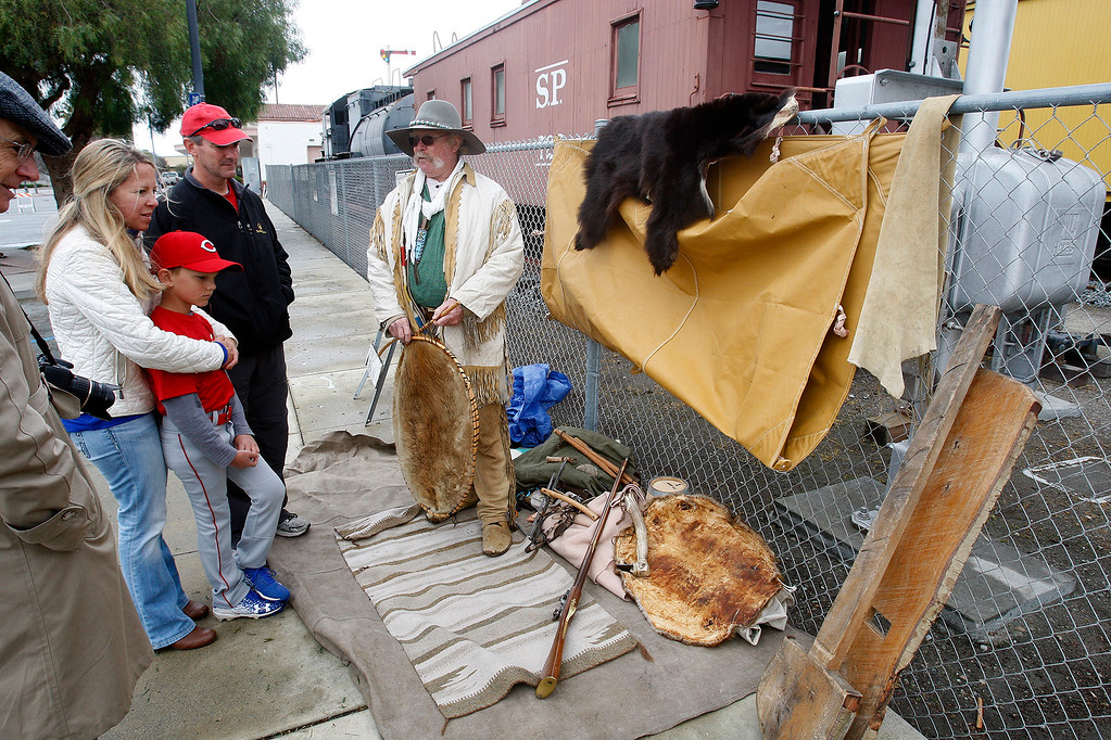 . Jack Swallow dressed as a fur trapper from the 1820s entertains the crowd at the Salinas Founders Day program on Saturday, April 8, 2017 at the Train Station Plaza in Salinas  It�s free and open to the public.  (Vern Fisher - Monterey Herald)