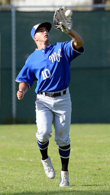 . Monte Vista Christian\'s Cody Paresa reels in a hit in center field during baseball in Pacific Grove on Wednesday April 12, 2017. (David Royal - Monterey Herald)