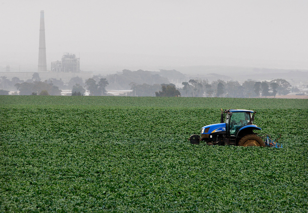 . A tractor sits in a field north of Moss Landing on Monday, Agust 27, 2018.  (Vern Fisher - Monterey Herald)