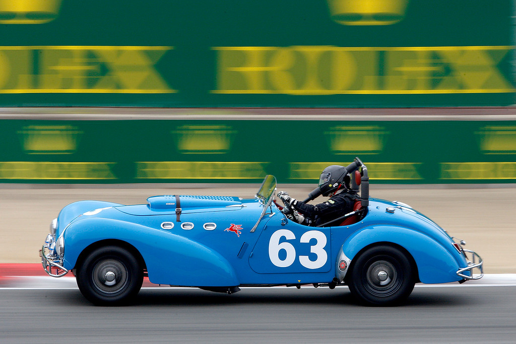 . John Mote drives his 1950 Allard K2 through turn-3 during the practice session of 1947-1955 sports racing and GT cars at the Rolex Motorsports Reunion at WeatherTech Raceway Laguna Seca on Friday, August 24, 2018.  (Vern Fisher - Monterey Herald)