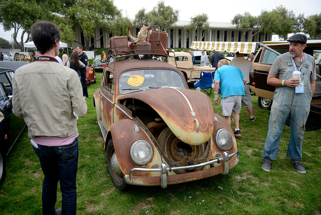 . Randy Carlson shows his rusted 1960 VW Beetle at the Concours d\'LeMons in Seaside on Saturday, August 25, 2018.  (Vern Fisher - Monterey Herald)