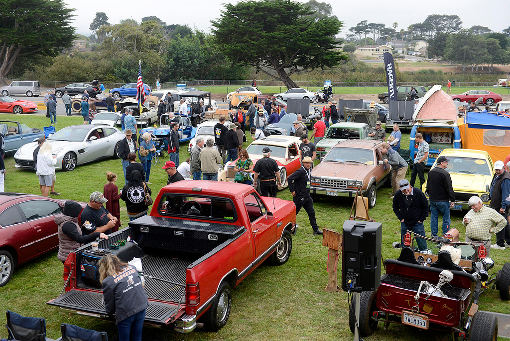 . People check out the unique cars at the Concours d\'LeMons in Seaside on Saturday, August 25, 2018.  (Vern Fisher - Monterey Herald)