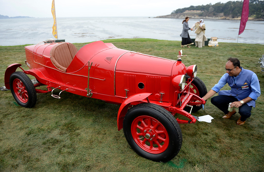 . Amal Tanna tends to his 1921 Fiat 501 S Corsa Race Car at the Pebble Beach Concours d\'Elegance on Sunday, August 26, 2018.  (Vern Fisher - Monterey Herald)