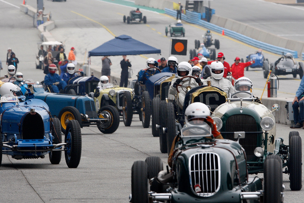 . A traffic jam in pit lane during the practice session of pre-1940 sports racing, touring and race cars during the Rolex Motorsports Reunion at WeatherTech Raceway Laguna Seca on Friday, August 24, 2018.  (Vern Fisher - Monterey Herald)