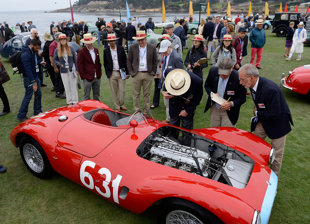 . Concours judges Jonathan Feber, Dave McCarthy and Leslie Burd at work on a 1955 Maserati A6GCS Frua Spyder at the Pebble Beach Concours d\'Elegance on Sunday, August 26, 2018.  (Vern Fisher - Monterey Herald)