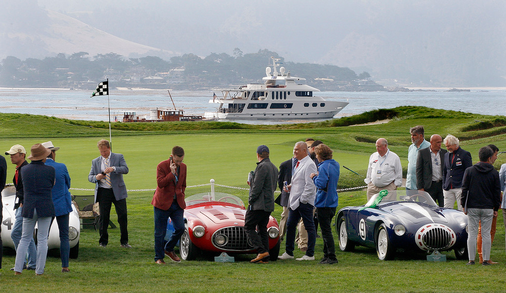 . Cars around the 17th green at the Pebble Beach Golf Links at the Pebble Beach Concours d\'Elegance on Sunday, August 26, 2018.  (Vern Fisher - Monterey Herald)