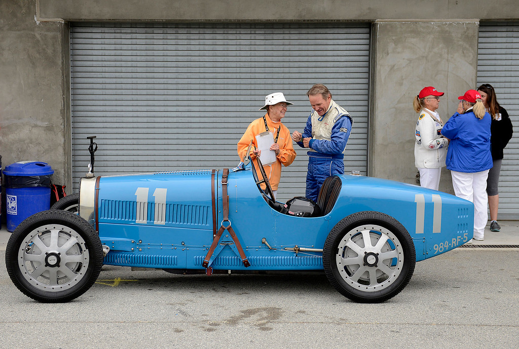 . Rick Rawlins prepares to drive his 1926 Bugatti 37A at the Rolex Motorsports Reunion at WeatherTech Raceway Laguna Seca on Friday, August 24, 2018.  (Vern Fisher - Monterey Herald)