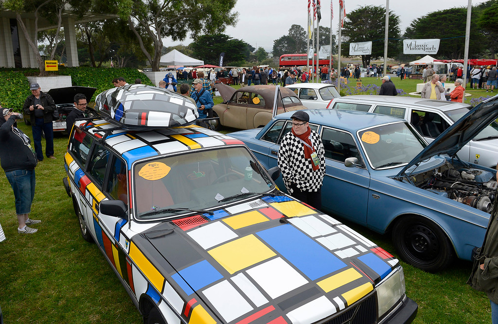 . Jes Muse from San Francisco shows her 1990 Volvo 240 Wagon at the Concours d\'LeMons in Seaside on Saturday, August 25, 2018.  (Vern Fisher - Monterey Herald)