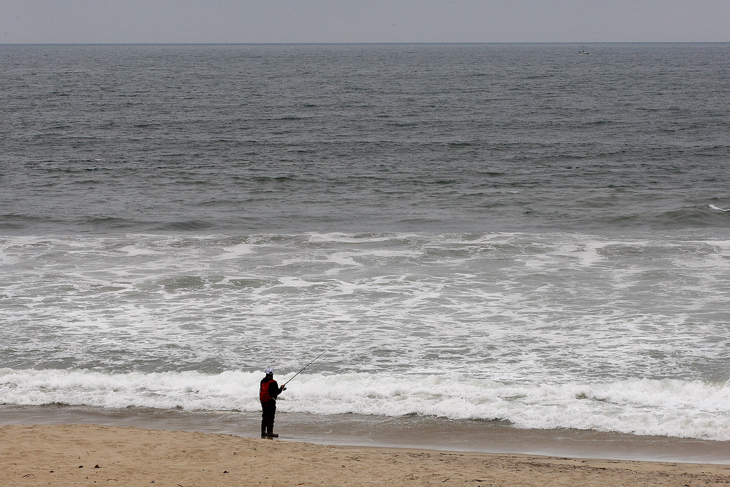 . A man surf fishes at Salinas River State Beach south of Moss Landing on Monday, August 27, 2018.  (Vern Fisher - Monterey Herald)
