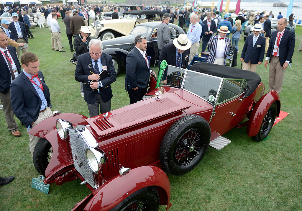 . Judges look over a 1928 Alfa Romero 6C 1500 S at the Pebble Beach Concours d\'Elegance on Sunday, August 26, 2018.  (Vern Fisher - Monterey Herald)