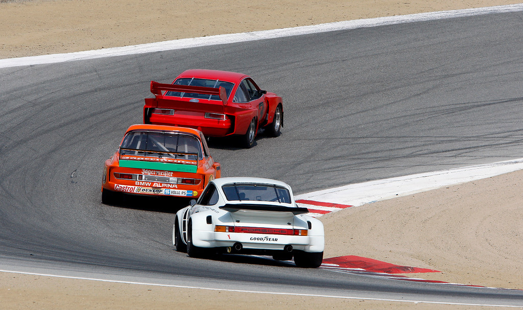 . A trio of cars through turn-10 during the practice session at the Rolex Motorsports Reunion at WeatherTech Raceway Laguna Seca on Friday, August 24, 2018.  (Vern Fisher - Monterey Herald)