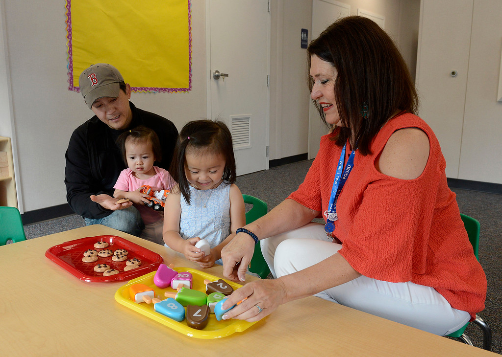 . Tony Van with his two daughters Allison, 1, and Claire, 4, with Barbara Martinez, principal at the new Pacific Grove Adult Education Child Development Center in Pacific Grove on Wednesday, August 29, 2018.  (Vern Fisher - Monterey Herald)