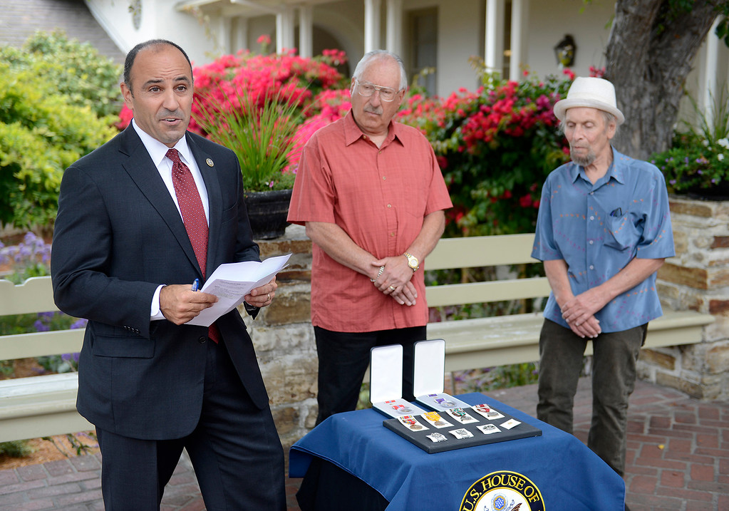 . Congressman Jimmy Panetta conducts a ceremony to issue military medals awarded posthumously to U.S. Army Tech Sergeant David Schultz in a ceremony with Arthur and Gary Schultz, the sons of David Schultz in Monterey on Tuesday, August 28, 2018.  (Vern Fisher - Monterey Herald)