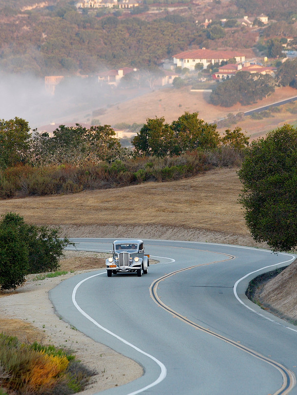 . George Teebay drives his 1934 Pierce Arrow to Laguna Seca on Thursday, Agust 9, 2018 to participate in the California\'s Dream Drive celebrating the reopening of Highway 1.  Dozens of classic cars and modern day motor vehicles are gearing up to convoy from Monterey County to San Luis Obispo County Thursday to celebrate the re-opening of California\'s Highway 1.To mark the reopening of the iconic roadway, a car representing each of the 84 years the highway has been open for travel will make the coastal journey as part of California\'s Dream Drive, said Brad Littlefield with WeatherTech Raceway Laguna Seca.(Vern Fisher - Monterey Herald)